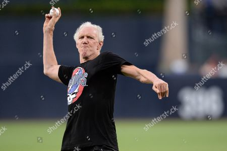 Former basketball player and sportscaster Bill Walton throws out the ceremonial first pitch before the baseball game between the San Diego Padres and the Colorado Rockies, in San Diego