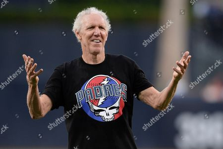 Former basketball player and sportscaster Bill Walton gestures after throwing out the ceremonial first pitch before the baseball game between the San Diego Padres and the Colorado Rockies, in San Diego