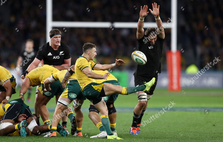 Samuel Whitelock of the All Blacks attempts to charge down a kick from Nic White of the Wallabies