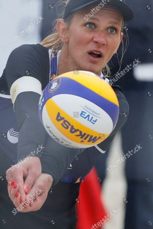 Stock Photo of Germany's Margareta Kozuch plays the ball during the Beach Volleyball European Championship round of 24 match between Germany's Laura Ludwig and Margareta Kozuch and Spain's Angela Lobato and Amaranta Fernandez in Moscow, Russia