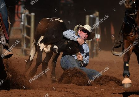 Stock Picture of Jamie Reynolds is seen during the Steer Wrestling event at the Mount Isa Mines Rotary Rodeo in Mount Isa, Queensland, Australia, 09 August 2019. This year's event marks 60 years of non-stop rodeo action that has grown to attract nearly 40,000 total attendees to the outback mining town.