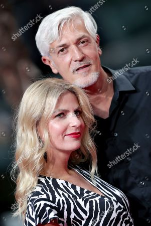 Tanja Buelter, front, and Nenad Drobnjak, rear, arrive for the Germany premiere of the movie 'Once Upon A Time in Hollywood' in Berlin, Germany