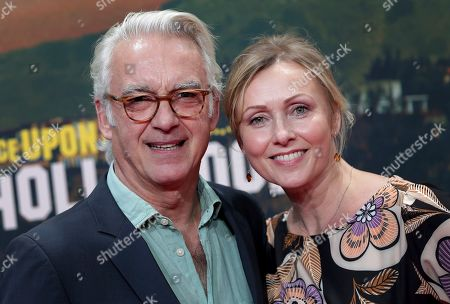 Stock Photo of Christoph M. Ohrt, left, and Dana Golombek, right, arrive for the Germany premiere of the movie 'Once Upon A Time in Hollywood' in Berlin, Germany