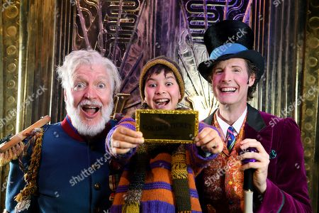 Stock Image of Tony Sheldon, Elijah Slavinskis and Paul Slade Smith pose for a photograph during a Charlie and the Chocolate Factory production media call at Her Majesty's Theatre in Melbourne, Victoria, Australia, 09 August 2019. The Charlie and the Chocolate Factory theater production opens in Melbourne tonight.
