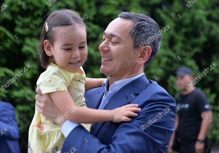 Omurbek Babanov, a former Prime Minister of Kyrgyzstan, holds his daughter as he returns to Kyrgyzstan in Bishkek, Kyrgyzstan, . Babanov, who has become an opposition leader, urged his supporters to observe public order and not to yield to provocations following the arrest of former president Almazbek Atambayev that sparked riots