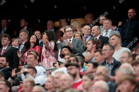 Liverpool owner John Henry applauds as he stands alongside his wife Linda Pizzuti centre left before the game