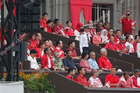 (L-R, 2nd row) Indonesian First Lady Iriana Widodo, Indonesian President Joko Widodo, Queen Saleha of Brunei, Sultan of Brunei, Siti Hasmah Mohamad Ali, her husband Malaysian Prime Minister Mahathir Mohamad, and Singapore Emeritus Senior Minister Goh Chok Tong are seen during the National Day Parade at the Padang in Singapore, 09 August 2019. Singapore celebrates its National Day annually on the 9th of August marking 54 years since its cessation from the Federation of Malaysia in 1965. This year also marks the bicentennial anniversary of the founding of modern Singapore by British colonialist Sir Stamford Raffles in 1819.