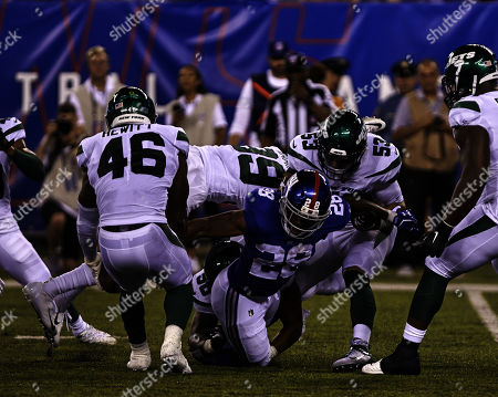 , 2019, East Rutherford, New Jersey, USA: New York Giants running back Paul Perkins (28) is stripped of the ball by New York Jets linebacker Neville Hewitt (46) during a preseason game between the New York Jets and the New York Giants at MetLife Stadium in East Rutherford, New Jersey