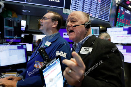 Robert Moran, Patrick King. Trader Robert Moran, right, and specialist Patrick King work on the floor of the New York Stock Exchange, . Stocks moved broadly lower in early trading On Wall Street Friday as investors again retreated to safer holdings in a market racked by fear and anxiety over trade disputes