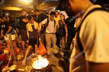 Anti-government protesters burn paper money to mark the Hungry Ghost Festival and to protest against the government in Wong Tai Sin, Hong Kong, China, 09 August 2019. Hong Kong has been gripped for weeks by mass protests, which began in June 2019 over a now-suspended extradition bill to China and have developed into an anti-government movement. The Ghost Festival 2019 will start on 15 August.