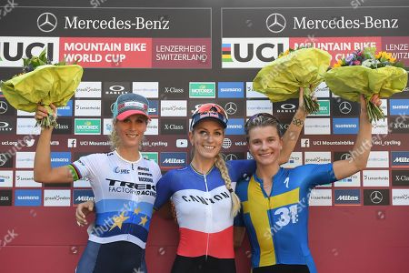 (L-R) Second placed Jolanda Neff of Switzerland, winner Pauline Ferrand Prevot of France and Jenny Rissveds of Sweden, from left pose after the Women's Elite Short Track at the UCI Cross Country Mountainbike World Cup, on Friday, August 9, 2019, in Lenzerheide, Switzerland.