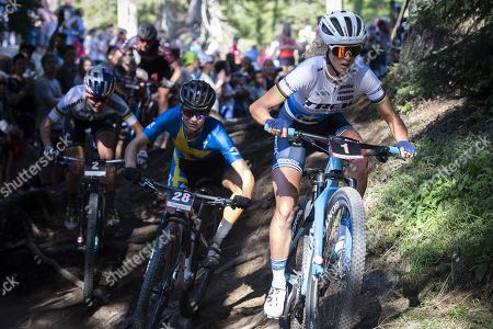 Jolanda Neff of Switzerland (R) and Jenny Rissveds of Sweden in action during the UCI Mountain Bike World Cup Short Track race in Lenzerheide, Switzerland, 09 August 2019.