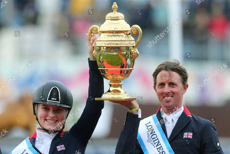 Great Britain's Emily Moffitt and Ben Maher celebrate winning the Aga Khan Trophy