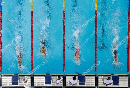 Brazil's Etiene Pires De Medeiros, left, touches the wall to win gold as Margo Geer of the United States, right, earns silver, and Madison Kennedy of the United States, second right, gets bronze, in the women's swimming 50m freestyle final at the Pan American Games in Lima, Peru, . Brazil's Lorrane Versiani Ferreira, second left, finished in fourth