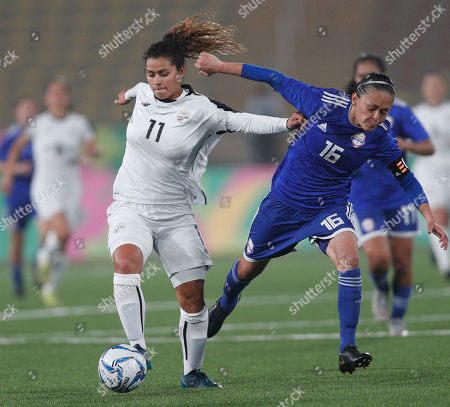 Raquel Rodriguez of Costa Rica, left, controls the ball under pressure from Dulce Quintana of Paraguay, during the women's bronze medal soccer match at the Pan American Games in Lima, Peru, . Costa Rica won bronze medal