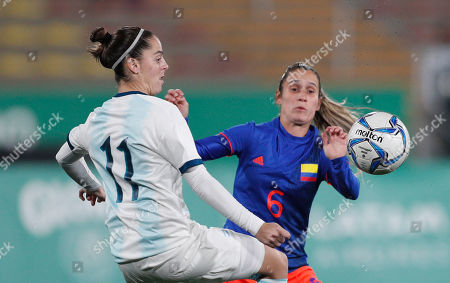 Stock Image of Mariana Larroquete of Argentina, left, fights for the ball with Daniela Montoya of Colombia, during the women's gold medal soccer match at the Pan American Games in Lima, Peru