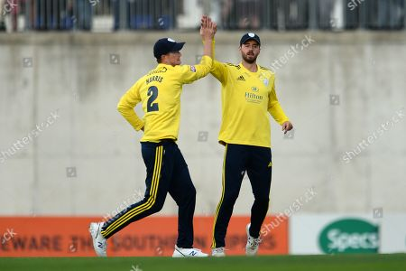 Chris Morris and and James Vince of Hampshire celebrate the wicket of Tom Banton during the Vitality T20 Blast South Group match between Hampshire County Cricket Club and Somerset County Cricket Club at the Ageas Bowl, Southampton