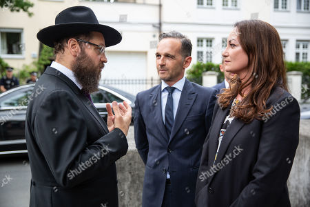 German Minister of Foreign Affairs Heiko Maas (C) and his  partner actress Natalia Woerner (R) are welcomed by Rabbi of the Jewish Community in Berlin, Rabbi Yehuda Teichtal (L) prior to a prayer service organized in solidarity with Teichtal at the Chabad Lubavitch synagogue in Berlin, Germany, 09 August 2019. According to reports, Rabbi Teichtal and his son were insulted and spat by two men as they were leaving after a service in a synagogue in Wilmersdorf neighborhood in Berlin on 26 July. Police is investigating the incident.