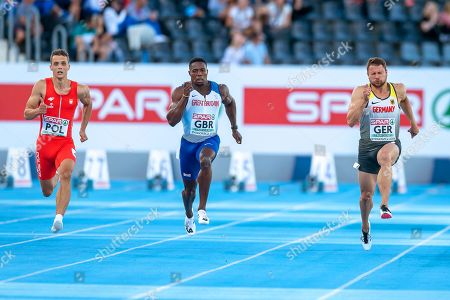 Stock Image of (L-R) Remigiusz Olszewski of Poland, Harry Aikines-Aryeetey of Britain, and Michael Pohl of Germany compete in the men's 100m heats during the European Athletics Team Championships Super League in Bydgoszcz, Poland, 09 August 2019.