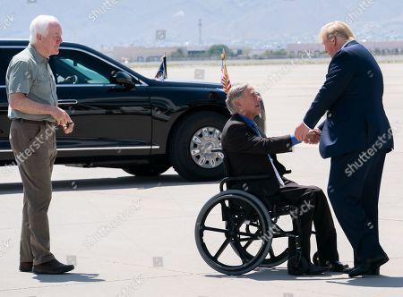 US President Donald Trump disembarks Air Force One at El Paso International Airport greeted by Texas Governor Greg Abbott, Senators John Cornyn and Ted Cruz, and El Paso Mayor Dee Margo