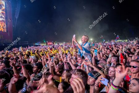 Revelers enjoy the performance of Dutch DJ Martin Garrix at the Sziget (Island) Festival on Shipyard Island, Northern Budapest, Hungary, 09 August 2019. The festival is one of the biggest cultural events of Europe offering art exhibitions, theatrical and circus performances and above all music concerts in seven days.
