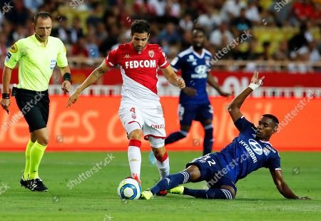Cesc Fabregas (C) of AS Monaco and Thiago Mendes (R) of Olympique Lyon in action during the French Ligue 1 soccer match between AS Monaco and Olympique Lyon in Monaco, 09 August 2019.