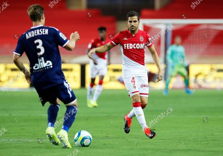 Cesc Fabregas (R) of AS Monaco and Joachim Andersen (L) of Olympique Lyon in action during the French Ligue 1 soccer match between AS Monaco and Olympique Lyon in Monaco, 09 August 2019.