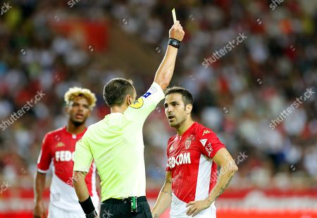 Cesc Fabregas (R) of AS Monaco is booked by French referee Ruddy Buquet (C) before being sent off during the French Ligue 1 soccer match between AS Monaco and Olympique Lyon in Monaco, 09 August 2019.