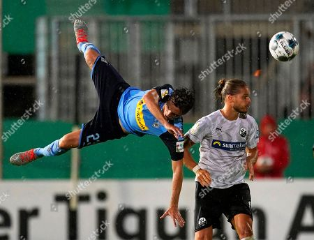 Sandhausen's Rurik Gislason (R) in action against Moenchengladbach's Jonas Hofmann (L) during the German DFB Cup first round soccer match between SV Sandhausen and Borussia Moenchengladbach in Sandhausen, Germany, 09 August 2019.