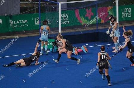Katherine Wright of Canada (3) celebrates on the ground after scoring against Argentina in a women's field hockey gold medal match during the Pan American Games in Lima, Peru