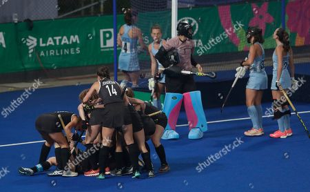 Canada's players celebrate Katherine Wright's goal against Argentina at their women's field hockey gold medal match during the Pan American Games in Lima, Peru