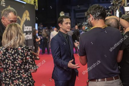 Joseph Gordon-Levitt (C) talks to members of the media on the red carpet at the Piazza Grande at the 72nd Locarno International Film Festival, in Locarno, Switzerland, 09 August 2019. The Festival del film Locarno runs from 07 to 17 August.