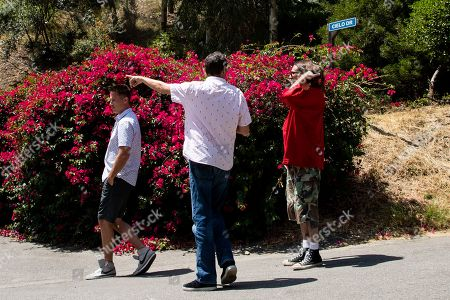 Stock Image of People take picture of the entrance of the road leading to number 10050 of Cielo Drive where actress Sharon Tate was killed along with Abigail Folger, Wojciech Frykowski, Steven Parent and Jay Sebring by members of the 'Manson Family' under direction of Charles Manson on the night of August 08 1969, in Beverly Hills, California, USA, 09 August 2019. Today marks the 50th anniversary of the Tate Murders.