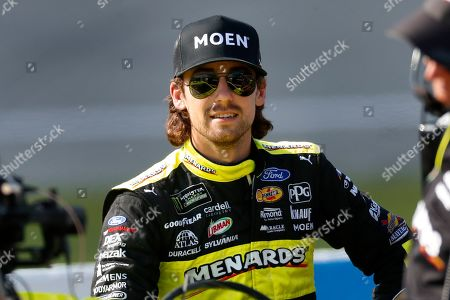 Ryan Blaney waits during qualifying for the NASCAR Cup Series auto race at Michigan International Speedway in Brooklyn, Mich