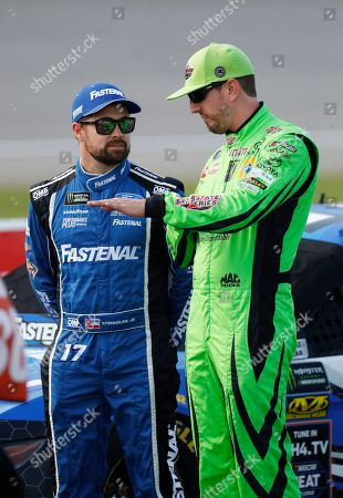 Ricky Stenhouse Jr., left, listens to Kyle Busch during qualifying for the NASCAR Cup Series auto race at Michigan International Speedway in Brooklyn, Mich