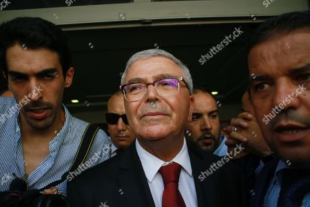 Tunisian Defence Minister Abdelkarim Zbidi is surrounded by supporters after submitting his candidacy