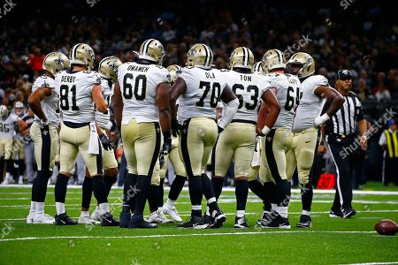 Stock Picture of The New Orleans Saints offensive unit, including tight end A.J. Derby (81), offensive guard Patrick Omameh (60), offensive tackle Michael Ola (70), center Nick Easton (62) and New Orleans Saints center Will Clapp (64), wait between plays in the second half of an NFL preseason football game against the Minnesota Vikings in New Orleans