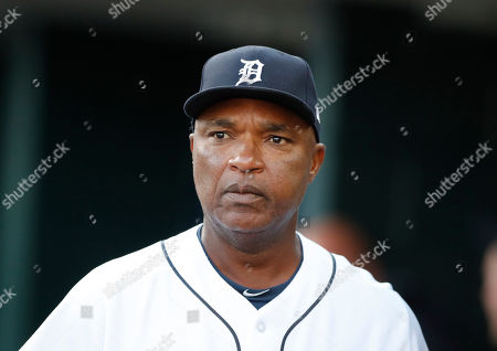 Detroit Tigers third base coach Dave Clark walks in the dugout during the first inning of a baseball game against the Kansas City Royals, in Detroit