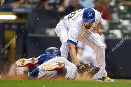 Stock Picture of Milwaukee Brewers relief pitcher Alex Claudio #58 tags out Texas Rangers runner Rougned Odor #12 at the plate on a wild pitch in the 6th inning of the Major League Baseball game between the Milwaukee Brewers and the Texas Rangers at Miller Park in Milwaukee, WI