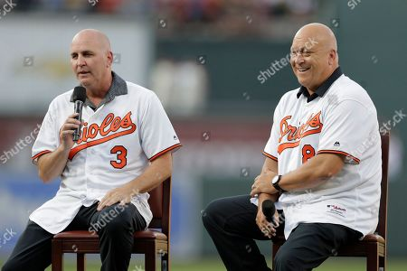 Former Baltimore Orioles infielder Billy Ripken, left, speaks as his brother and teammate Cal Ripken, Jr. listens during a ceremony honoring the 1989 team prior to a baseball game against the Houston Astros, in Baltimore