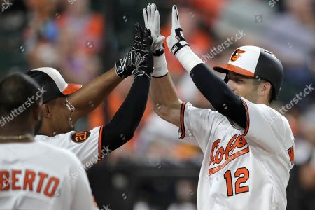 Stock Image of Baltimore Orioles' Stevie Wilkerson, right, is greeted by Richie Martin, center, and Hanser Alberto after hitting a solo home run off Houston Astros relief pitcher Joe Smith during the seventh inning of a baseball game, in Baltimore