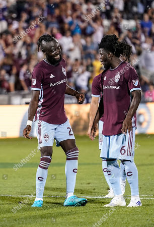 Colorado Rapids forward Kei Kamara (23) and Lalas Abubakar (6) celebrate a goal during the second half of an MLS soccer match, in Commerce City, Colo