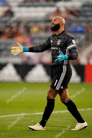 Colorado Rapids goalkeeper Tim Howard reacts during an MLS soccer match between the Colorado Rapids and the Montreal Impact, in Commerce City, Colo