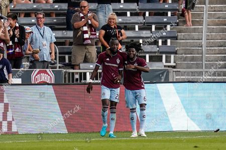 Colorado Rapids forward Kei Kamara (23) and Lalas Abubakar (6) celebrate a goal against the Montreal Impact during the first half of an MLS soccer match, in Commerce City, Colo