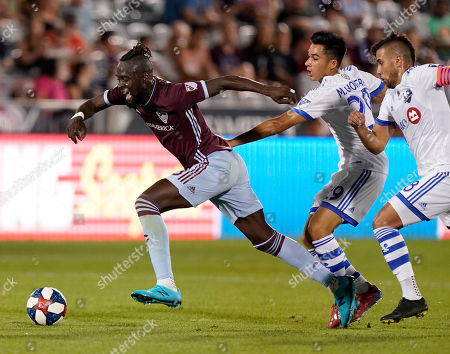 Colorado Rapids forward Kei Kamara chases the ball during the second half of an MLS soccer match, in Commerce City, Colo