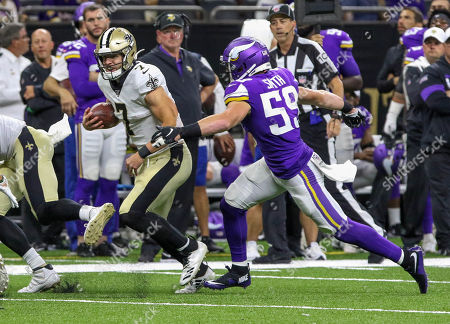 New Orleans Saints quarterback .Taysom Hill (7) runs around the end as Minnesota Vikings' linebacker Cameron Smith (59) tries to chase him down in the second half at the Mercedes Benz Superdome in New Orleans, LA