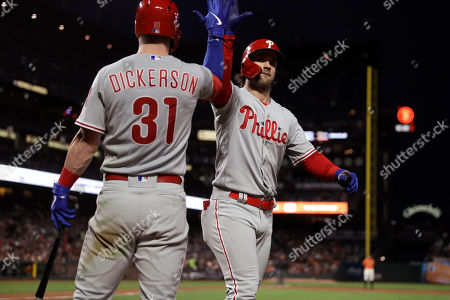 Stock Image of Corey Dickerson, Bryce Harper. Philadelphia Phillies' Bryce Harper, right, celebrates with Corey Dickerson (31) after hitting a home run off San Francisco Giants' Tyler Beede during the fifth inning of a baseball game, in San Francisco