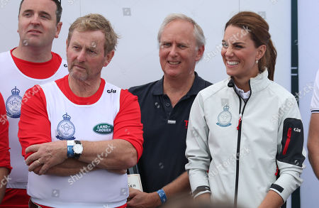 Former Taoiseach Enda Kenny with Catherine Duchess of Cambridge as he is awarded the King's Cup during the prize giving following the King's Cup regatta at Cowes on the Isle of Wight.