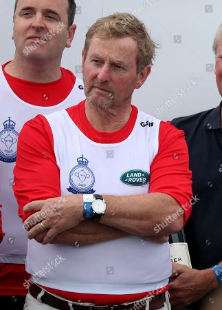 Former Taoiseach Enda Kenny as he is awarded the King's Cup during the prize giving following the King's Cup regatta at Cowes on the Isle of Wight.