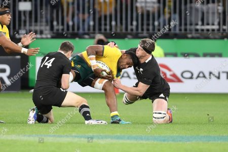 Australia's Isi Naisarani, centre, is tackled by New Zealand's Ben Smith and Scott Barrett during their rugby union test match in Perth, Australia